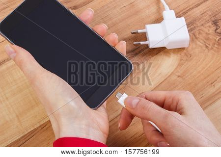 Hand Of Woman Connects Plug Of Charger Mobile Phone, Smartphone Charging