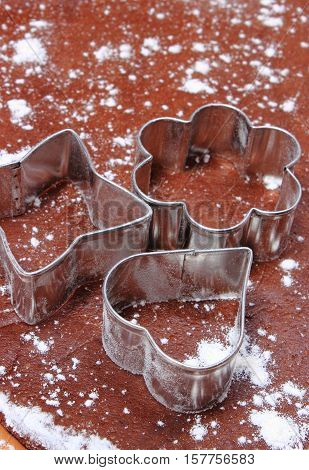 Cookie Cutters Lying On Dough For Cookies