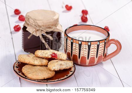Tasty breakfast, Oatmeal cookies with milk and jam