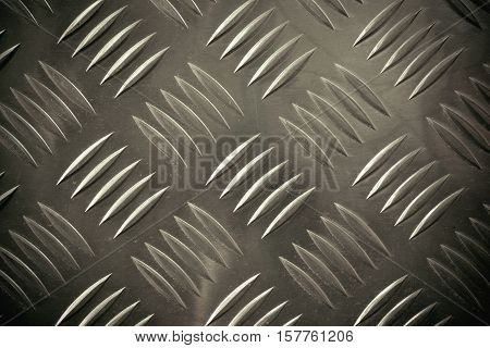 Old rusty checker plate floor texture background