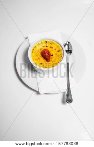 Top view shot of creme brule on white background.