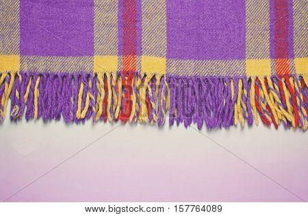 Violet, purple vintage blanket tartan plaid wth copy space, texture background, toned