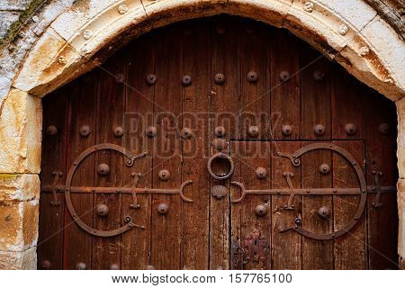 Zamora detail of old aged wood door in Spain by the via de la Plata way