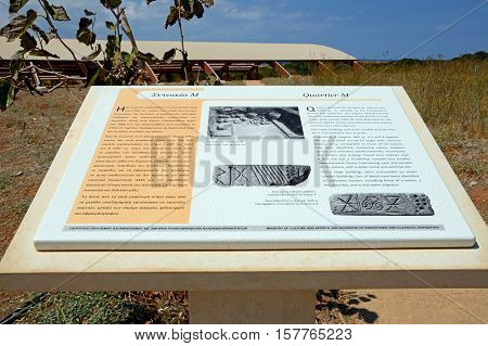 MALIA, CRETE - SEPTEMBER 14, 2016 - Information sign for the Palace of Malia Minoan ruins site showing the M quarter district Malia Crete Greece Europe, September 14, 2016.