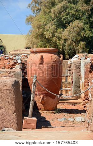 Ancient large decorated terracotta pot within the walls of the Minoan Malia ruins archaeological site Malia Crete Greece Europe.