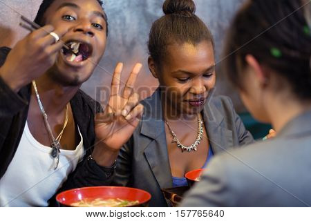 Group of young black people dining in Asian restaurant
