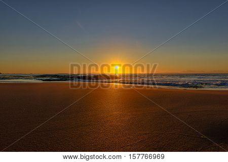 Sunrise on the Narrabeen Beach Sydney Australia.