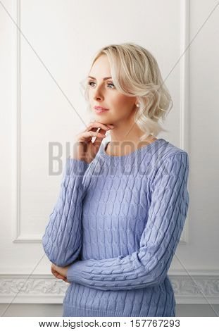 Young, beautiful and natural young woman at home. Fresh and attractive girl standing indoor.