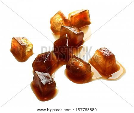 Iced coffee cubes on white background