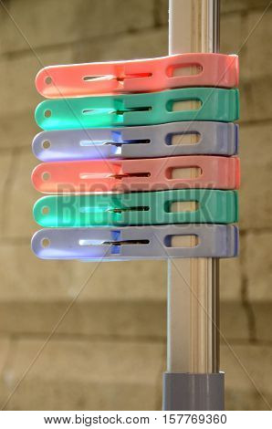 6 pieces of colorful plastic pegs on cloth line