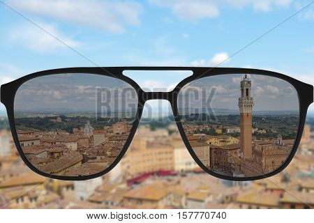 Clear image in sun glasses against blurry and sunny landscape