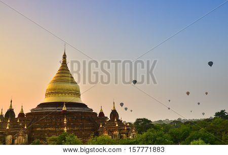 Dhammayazika pagoda in Bagan. Dhammayazika pagoda gilded with Bagan gold located east of Bagan, Mandalay, Myanmar. Natural light, soft focus due to long exposure.