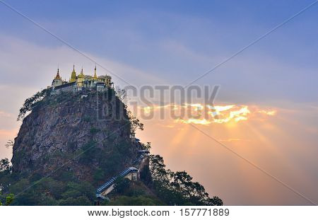 Mount Popa at dawn, Mt. Popa near Bagan, Mandalay, Myanmar. Popa monastery, Popa inactive volcano. Soft focus due to long exposure. Natural lights.
