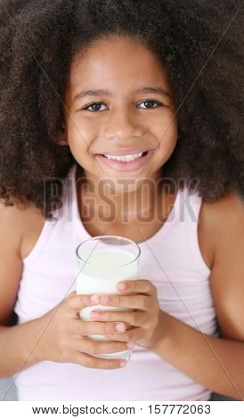Curly African-American girl drinking milk, closeup