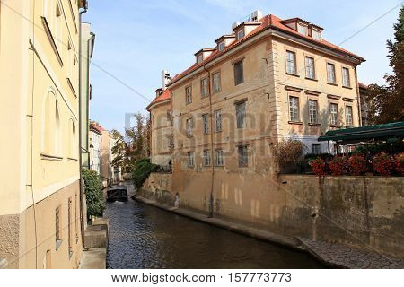 Old buildings and River Certovka in the district Mala strana, Prague, Czech Republic