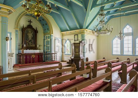 Hvolsvollur Iceland - June 27 2016: Interior of the church near Hvolsvollur with red benches and blue ceiling on Iceland.