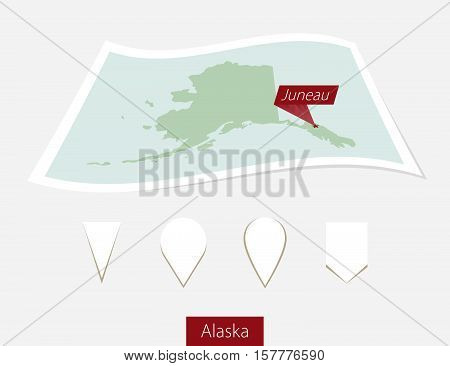 Curved Paper Map Of Alaska State With Capital Juneau On Gray Background. Four Different Map Pin Set.