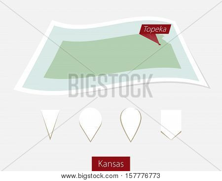 Curved Paper Map Of Kansas State With Capital Topeka On Gray Background. Four Different Map Pin Set.