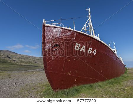 Westfjord Iceland - July 6 2016: Old red metal fishing ship at the beach at Patreksfjordur on Iceland