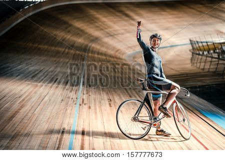 Smiling athlete with bicycle