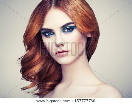Portrait of beautiful sensual woman with elegant hairstyle. Perfect makeup. Beauty fashion. Eyelashes. Lips. Cosmetic Eyeshadow