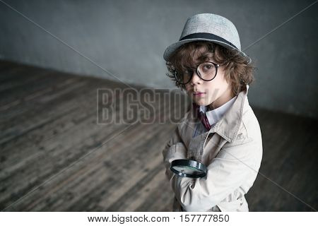 Little boy in a cloak indoors