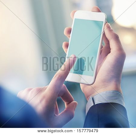 Mock up of a man holding device and touching screen. Clipping path