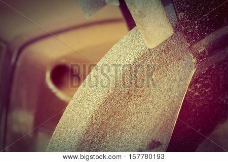 Fragment of the abrasive machine used us background. Retro style.