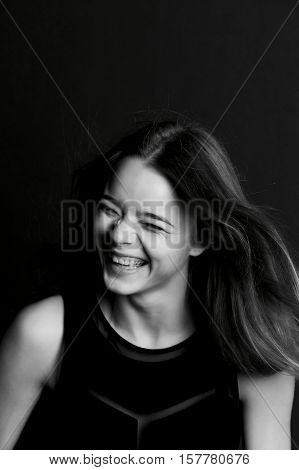 Emotional portrait of a beautiful girl with long hair. Broad good-natured happy smile