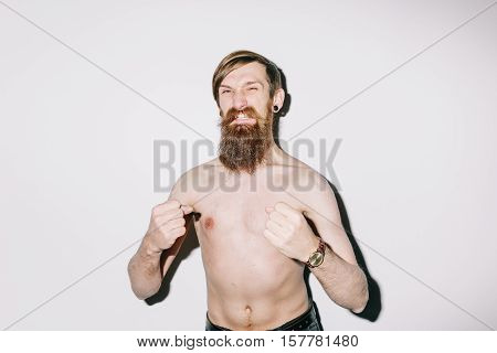Portrait of a thin man on a white studio background shouting