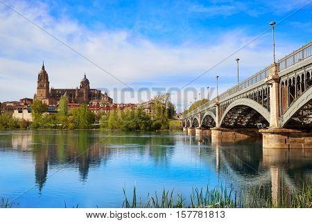 Salamanca skyline in Enrique Estevan bridge over Tormes river in Spain