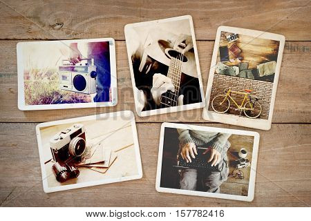 Photo album of hipster lifestyle journey trip in summer on wood table. instant photo of vintage camera - vintage and retro style