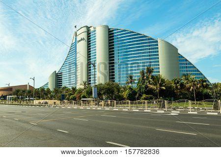 DUBAI UAE - NOVEMBER 9 2016: Jumeirah beach Hotel in Dubai modern architecture luxury beach resort summer vacation and tourism concept. Jumeirah beach