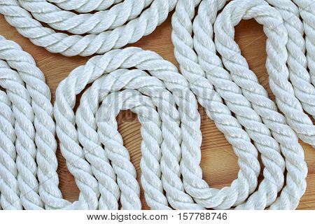 The twisted rope lying on a wooden board