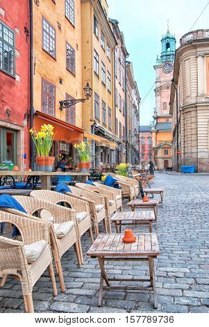 STOCKHOLM, SWEDEN - APRIL 11, 2010: Street cafe in Gamla Stan (Old Town) near Stortorget (Main Square). On the background is The Saint Nicolas Church