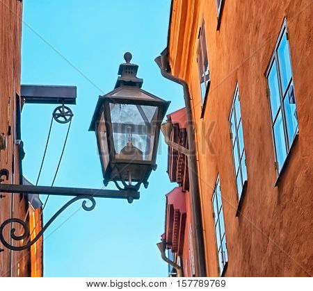 Swden. Stockholm. Retro lantern on the wall on one of the streets in Gamla Stan