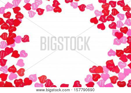 border of colorful Valentines Day paper hearts against a white background