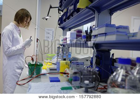 ST. PETERSBURG, RUSSIA - NOVEMBER 16, 2016: Researcher at work in the High-Throughput Biotechnology Laboratory of BIOCAD. It is one of the few full-cycle drug development and manufacturing companies