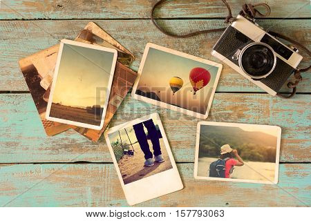 Photo album remembrance and nostalgia in summer journey trip on wood table. instant photo of vintage camera - vintage and retro style