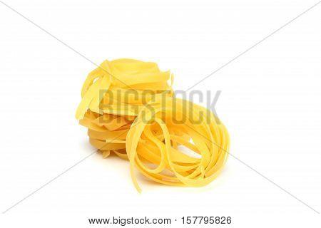 Italian fettuccine pasta isolated on white background.