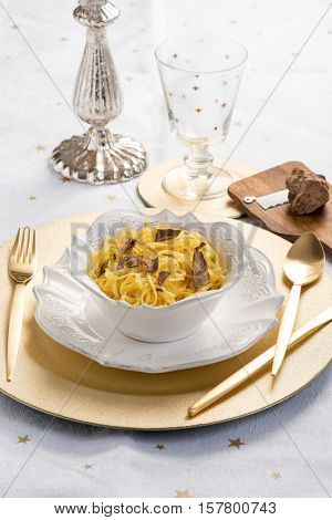 tagliolini with white truffle over christmas table
