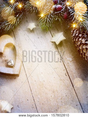 Christmas composition; Christmas decoration fir tree branches holidays light on wooden background; Top view with copy space for your text