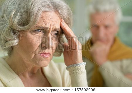 Portrait of sad senior couple looking away