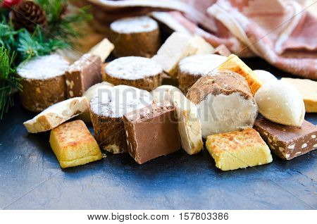 Different Spanish sweets consumed at Christmas: polvoron or shortbread turron or almond nougat.