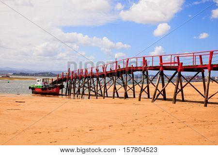 View of jetty in the El Puntal beach in Somo Santander. Spain