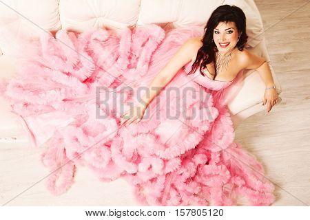Beautiful brunette in formal pink dress