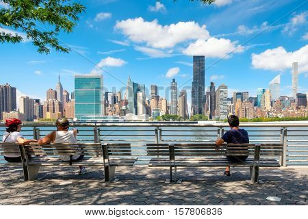 New YORK,USA - AUGUST 21,2016 : NewYorkers relaxing at a park in Queens with a view of the midtown Manhattan skyline