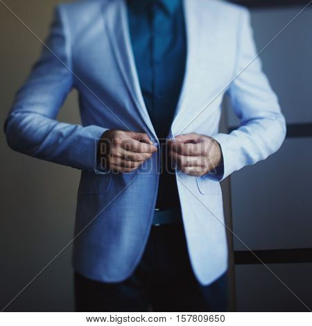 Young man wears the light blue jacket