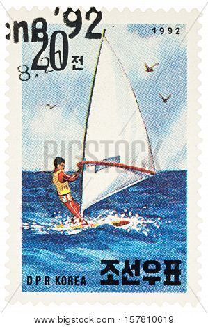 MOSCOW RUSSIA - NOVEMBER 21 2016: A stamp printed in DPRK (North Korea) shows windsurfer in the sea series