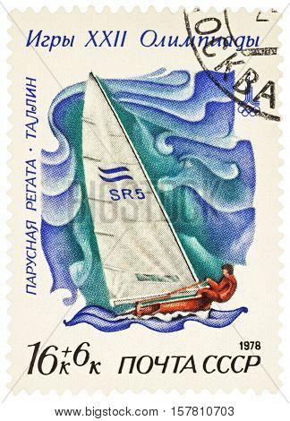 MOSCOW RUSSIA - NOVEMBER 22 2016: A stamp printed in USSR (Russia) shows racing yacht in Finn class in Tallinn series